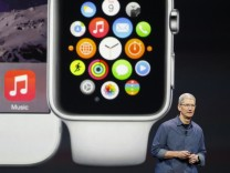 File photo of Apple CEO Tim Cook speaking during an Apple event announcing the iPhone 6 and the Apple Watch at the Flint Center in Cupertino