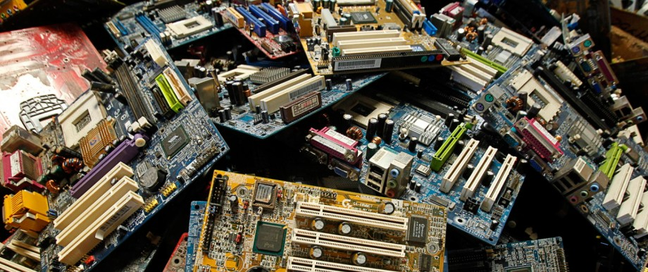 Discarded electronic parts are seen at a newly opened electronic waste recycling factory in San Jose