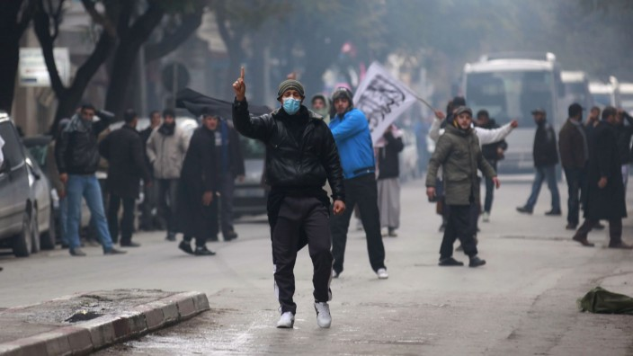 Protesters gesture as they shout 'Allahu Akbar' (God is Greatest) during a demonstration, in Tunis