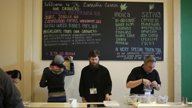 Employees make last-minute preparations before the grand opening of The Cannabis Corner in North Bonneville