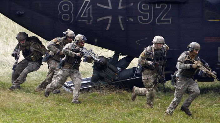 Members of German army Bundeswehr Special Forces Command leave a helicopter while demonstrating their skills at the Vehicle Interdiction training in Claw near Stuttgart