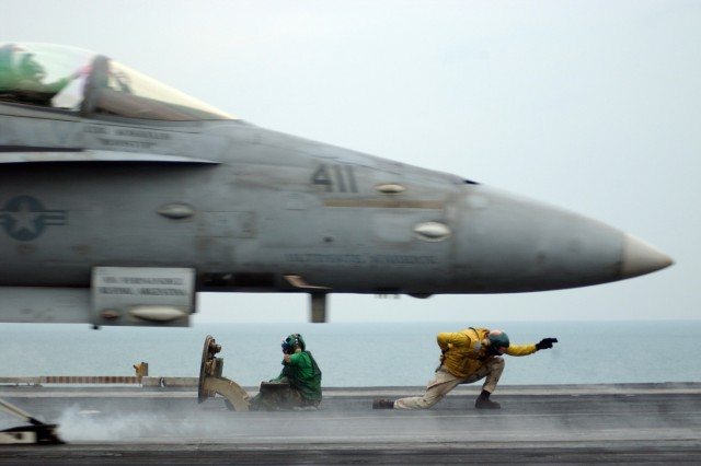 F/A-18C Hornet launches off the USS Theodore Roosevelt in the Persian Gulf