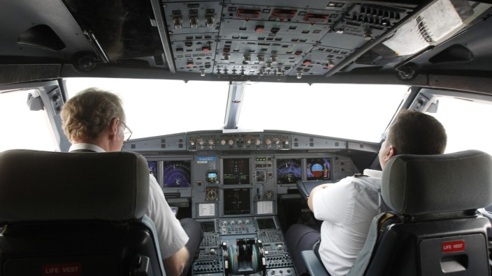 Pilots sit at the cockpit of a VietJet  A320 airplane before departure for Bangkok in this file photo