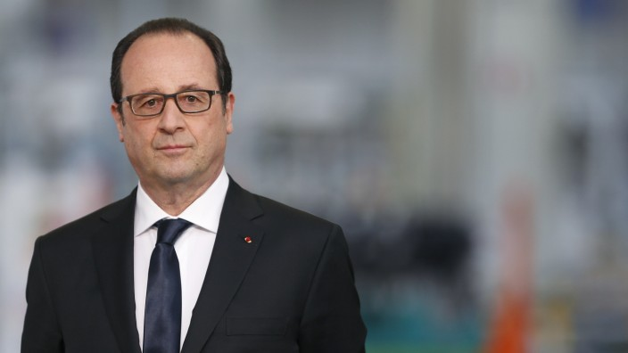 French President Hollande waits to deliver a speech after a visit at the French carmaker PSA Peugeot Citroen engine factory in Tremery near Metz