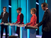 Leaders of Britain's main political parties stand during the leaders televised election debate at Media City in Salford in Northern England