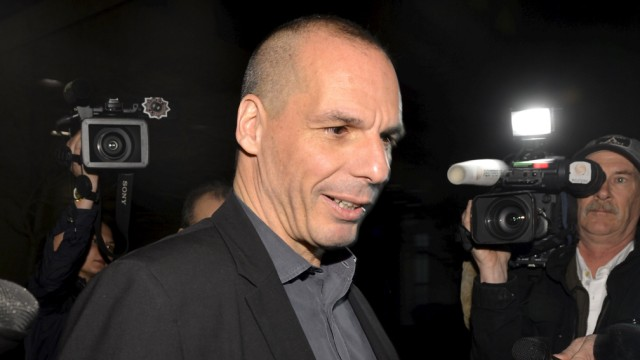 Greek Finance Minister Varoufakis is surrounded by members of the media as he comments on the 'informal discussions' he had just concluded with the International Monetary Fund Managing Director Christine Lagarde, in Washington