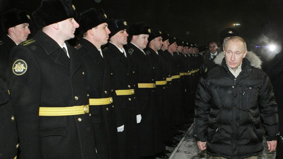 Russia's Prime Minister Putin walks past seamen as he visits Sevmash shipyard in Severodvinsk