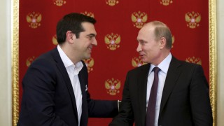 Russian President Putin and Greek Prime Minister Tsipras attend a signing ceremony at the Kremlin in Moscow