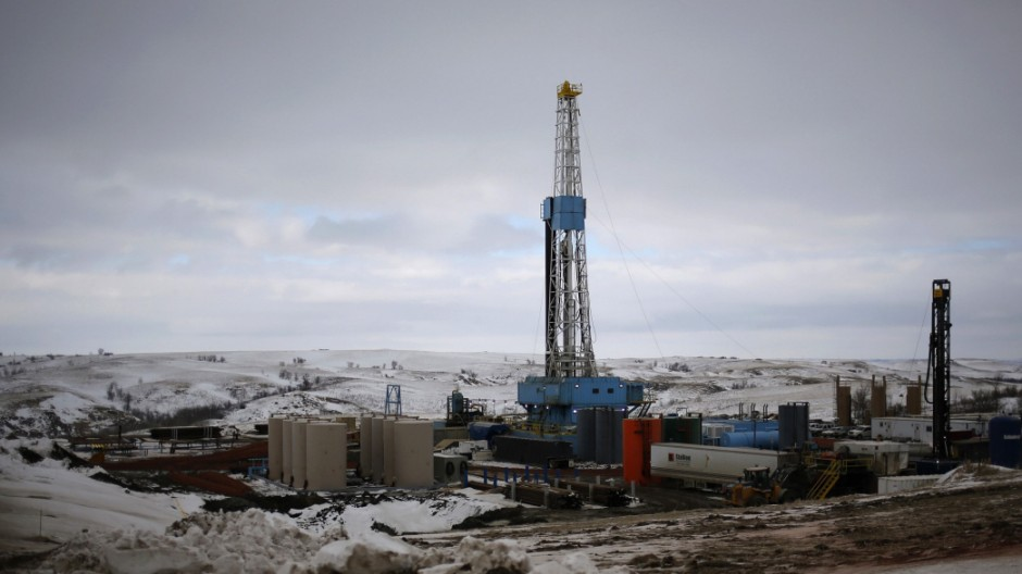 File photo of an oil derrick is seen at a fracking site for extracting oil outside of Williston
