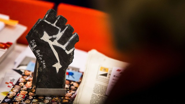 Stone sculpture in shape of clenched fist is seen on table of delegate during congress of the Federation of German Unions (DGB) in Berlin