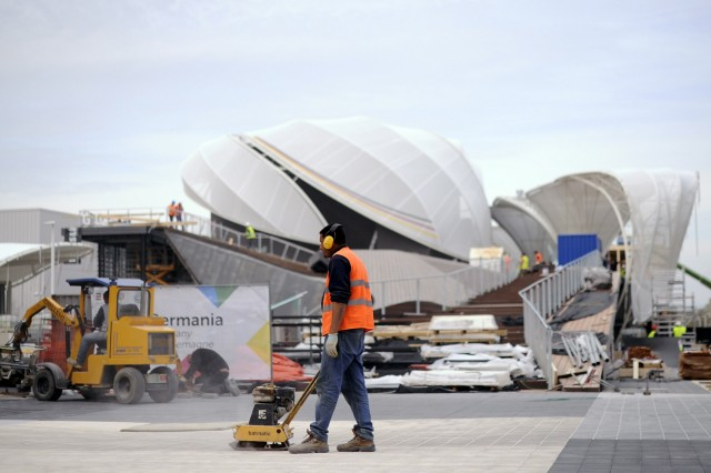 A worker is pictured near the German pavilion at the Expo 2015 work site near Milan