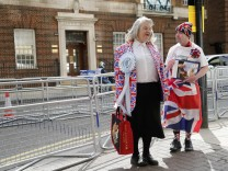 Fans of the royal family wear a union flag themed attire outside the Lindo Wing of St Mary's hospital in London