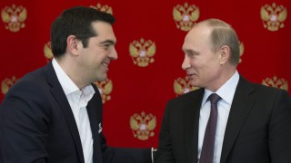 Russian President Vladimir Putin meets with Greek Prime Minister