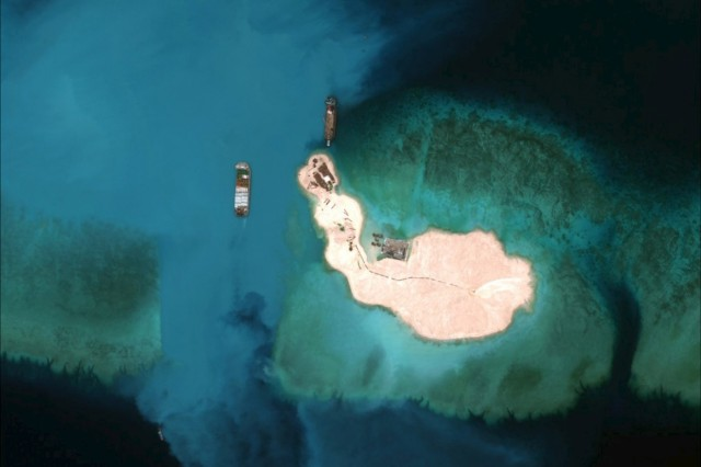 Satellite image of cargo being unloaded onto the shore of the Mischief Reef