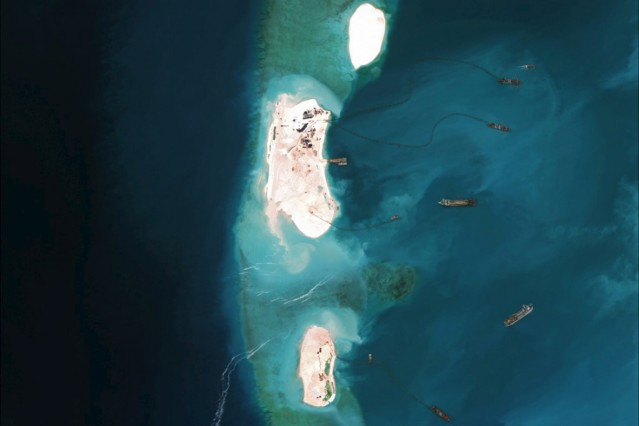 Satellite image of dredgers reinforcing a site being constructed on the westernmost part of Mischief Reef