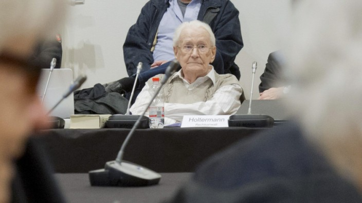 Former bookkeeper at Auschwitz Groening waits for start of his trial in Lueneburg
