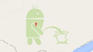 Android Männchen von Google uriniert auf Apple Logo