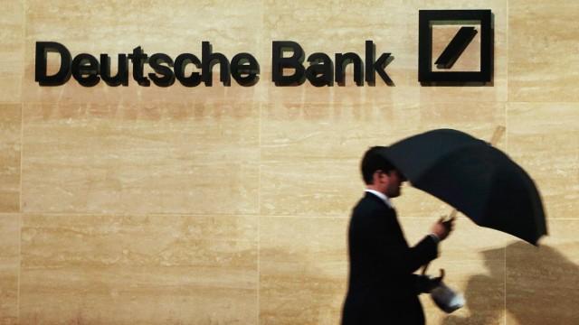 File photo of man walking past Deutsche Bank offices in London; .
