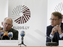 German Bundesbank President Weidmann listens as German Minister of Finance Schauble speaks at a news conference at the end of an informal meeting of Ministers for Economic and Financial Affairs (ECOFIN) in Riga