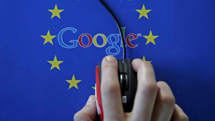 A woman hovers a mouse over the Google and European Union logos in Sarajevo