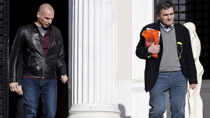 Greek Finance Minister Varoufakis and deputy minister for international economic relations Tsakalotos leave the Maximos Mansion after a meeting with PM Tsipras in Athens