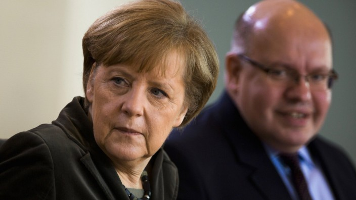 German Chancellor Merkel and Head of Federal Chancellery Altmaier attends cabinet meeting at the Chancellery in Berlin