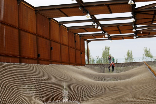 People walk in the Brazilian pavillion at Expo 2015 in Milan