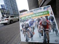 A placard referring to the Frankfurt May Day cycle race is pictured downtown Frankfurt