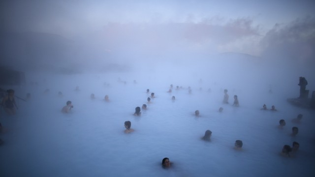 File photo of people relaxing in one of the Blue Lagoon hot springs near the town of Grindavik