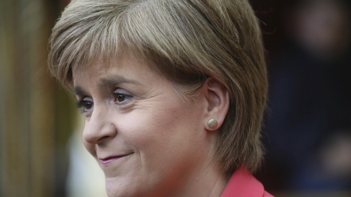 First Minister for Scotland Nicola Sturgeon smiles during a campaign visit to a theme park in Motherwell, central Scotland