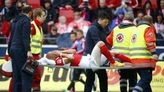 Medics carry FSV Mainz 05 Elkin Soto off the pitch after his collision with Hamburg SV's Rafael van der Vaart during their German first division Bundesliga soccer match in Mainz