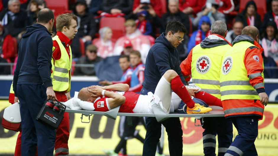 Medics carry FSV Mainz 05 Elkin Soto off the pitch after his collision with Hamburg SV's Rafael van der Vaart during their German first division Bundesliga soccer match in Mainz