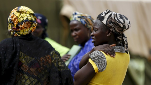 Women gather at a camp for Internally Displaced People as more women and children rescued from Sambisa arrive in the camp in Yola, Nigeria