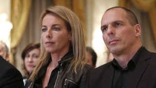 Greek Finance Minister Yanis Varoufakis and his wife Danae Stratou attend a banking conference in Athens