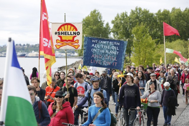 Activists protest the Polar Pioneer, an oil rig leased by Royal Dutch Shell Plc that is bound for the Arctic, at a rally and march in Seattle, Washington