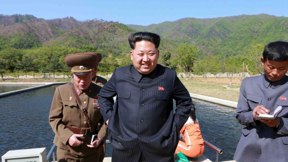 KCNA picture of North Korean leader Kim Jong Un visiting the Anbyon Fish Farm