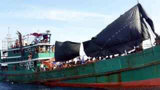 Rohingya migrants on a drifting abandoned boat found in Thai sea