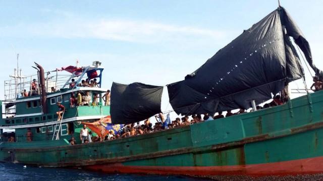 Rohingya migrants on a drifting abandoned boat found in Thai sea