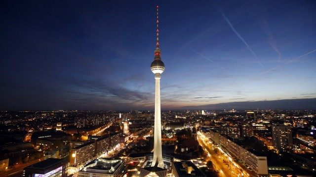 Berlin's city skyline, with the TV tower at Alexanderplatz square, is seen at sunset in Berlin