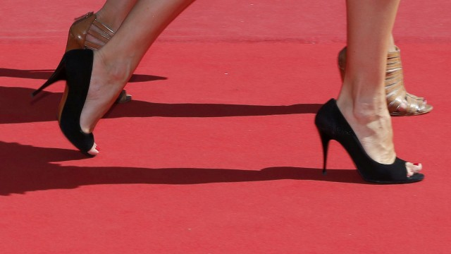 Guests walk on the red carpet as they arrive for the screening of the film 'La loi du marche' in competition at the 68th Cannes Film Festival in Cannes
