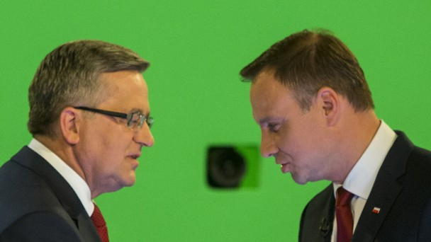 Komorowski and Duda shake hands during their face-to-face televised debate at the TVN studio in Warsaw