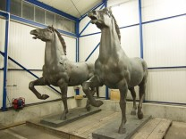 A police handout shows two recovered bronze sculptures made for Adolf Hitler's imposing Reich Chancellery that have been missing for years and are now stored in a police compound in the western German town of Bad Bergzabern