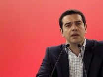 Greek PM Tsipras delivers  his speech during a central committee of leftist Syriza party in Athens