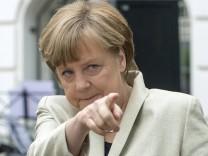 German Chancellor Merkel gestures during her visit to the Roentgen school in Berlin
