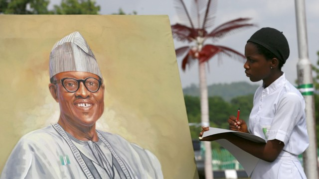 An art student takes part in a competition by drawing a portrait of President-elect Muhammad Buhari, during an art exhibition by Malami Leadership Foundation showcasing portraits of Nigeria's former presidents and heads of state in Abuja