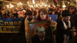 Activists of the Svoboda (Freedom) Ukrainian nationalist party hold torches as they take part in a rally to mark the 105th year since the birth of Stepan Bandera in Kiev