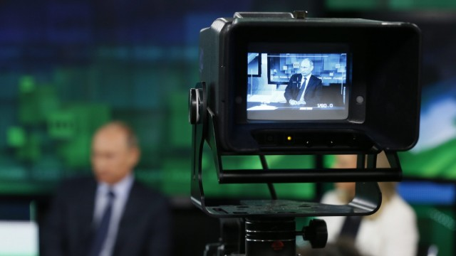 Russian President Vladimir Putin visits the new studio complex of