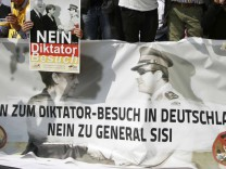 Demonstrators protest against Egypt's President Sisi opposite the Chancellery in Berlin