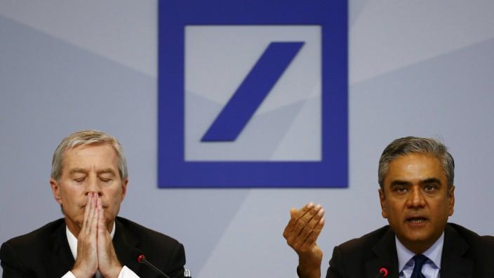 Jain and Fitschen, co-CEOs of Deutsche Bank, address a news conference in Frankfurt