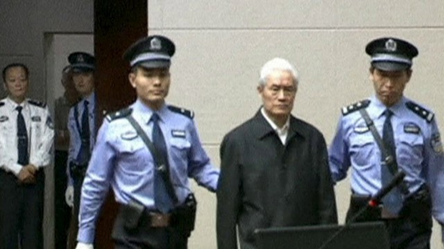 Still image of Zhou Yongkang, China's former domestic security chief, escorted into court for his sentencing in Tianjin
